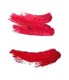 白い背景で隔離の口紅の赤い汚れ見本