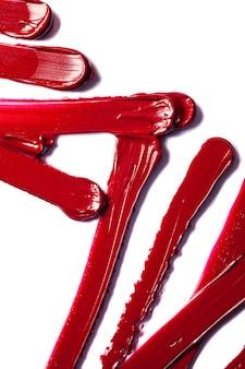 Lipstick smudge sample swatch wave red maroon burgundy texture background