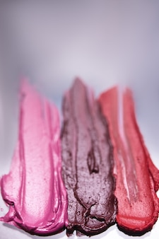 Lipstick swatch smudged in selective focus background. cosmetics commercial, female style. glamorous magazine, beauty concept