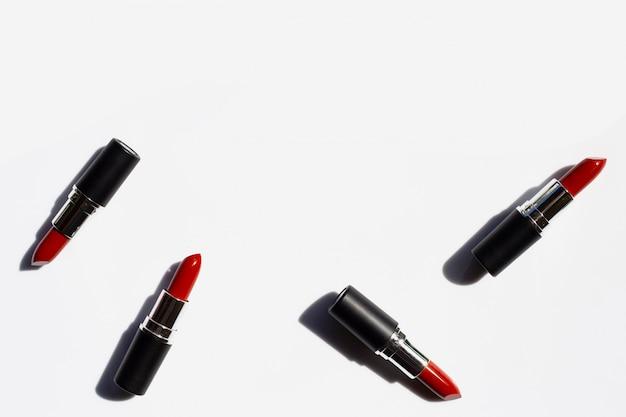 Lipsticks on white with shadow.