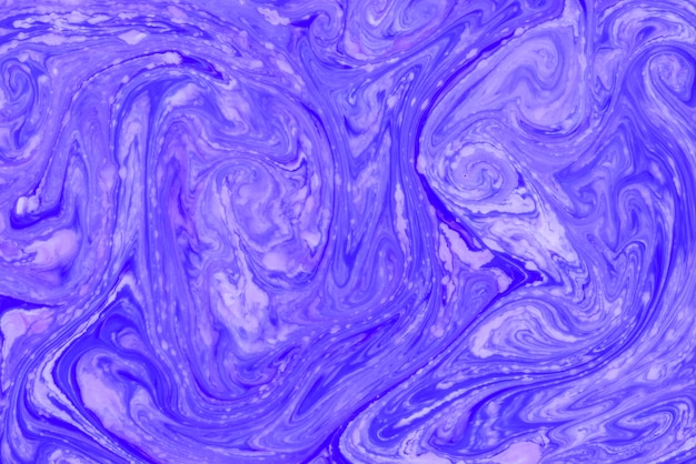 Liquid blue and lavender paint marbling backdrop
