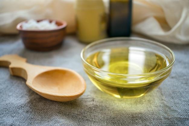 Liquid coconut mct oil in round glass bowl