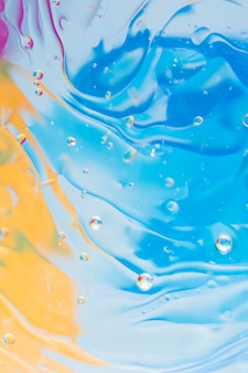 Liquid effect on the blue and yellow painted background