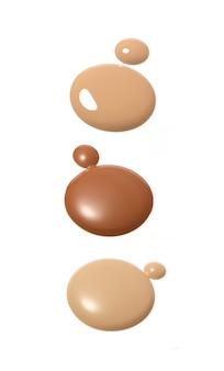 Liquid foundation in different shades on white Premium Photo