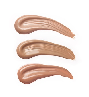 Liquid foundation strokes in different shades isolated on white