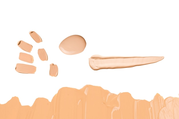 Liquid foundation swatch isolated on white background. close up of makeup cream sample.
