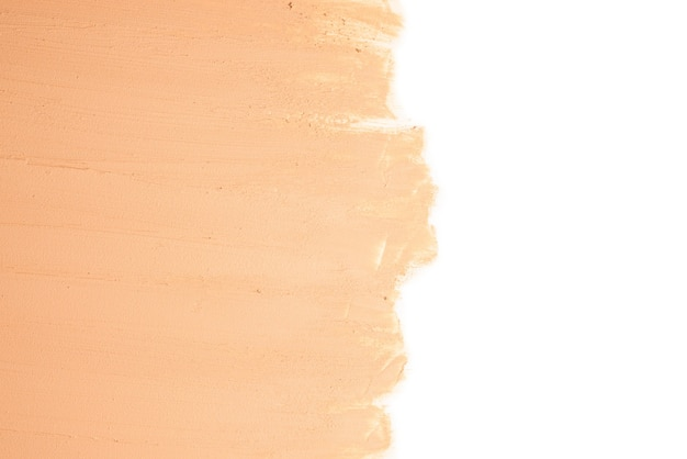 Liquid foundation texture. make up for women. top view. isolated on white. space for text or design.