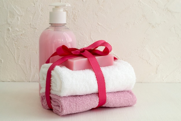 Liquid soap and two towels