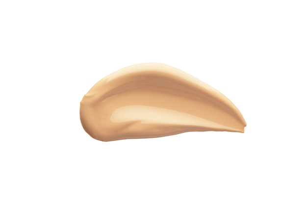 Liquid tone cream swipe. foundation for facial skin correction. nude makeup smudge.