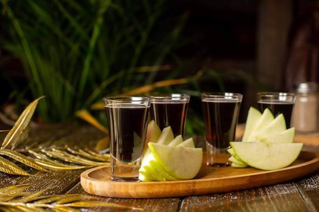 Liquor shots served with apple slices