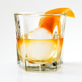 Liquour with an orange peel cocktail