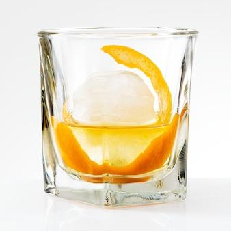 Liquour with an orange peel cocktail