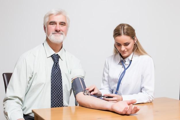 Listening hospital pulse sitting woman his