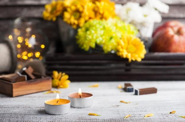 Lit candles, chrysanthemum and lit lights