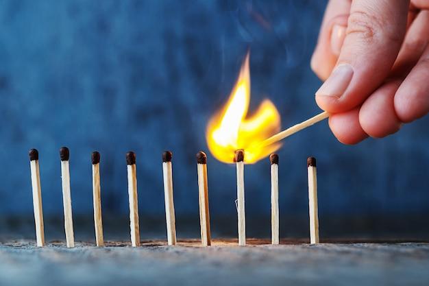 Lit match fires another match