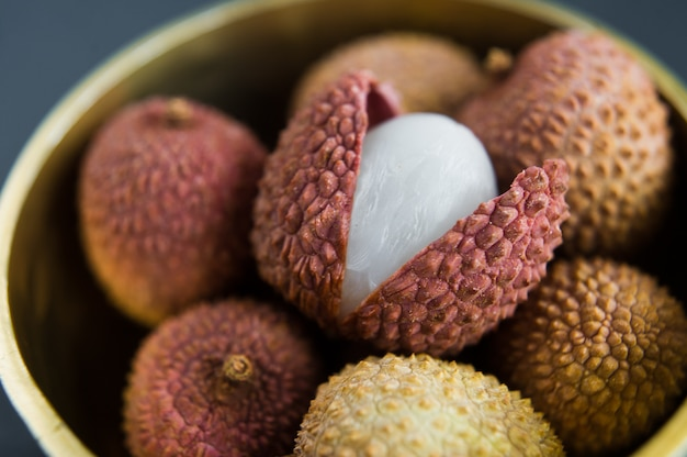 Litchi in a golden bowl.