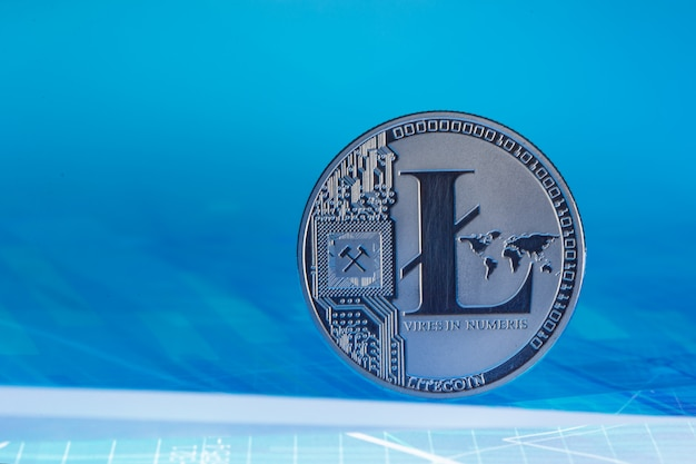 Litecoin on blue abstract finance background. bitcoin cryptocurrency