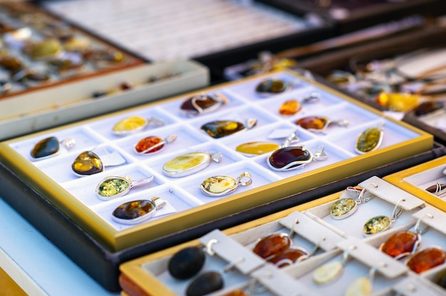 Lithuania. amber jewelry in various colors for sale on the lithuanian open market.