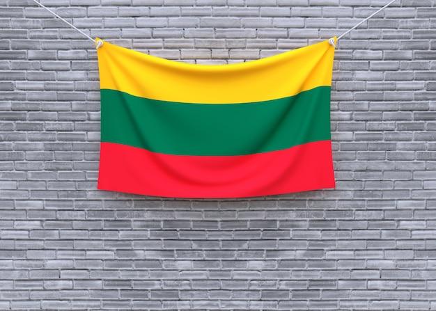 Lithuania flag hanging on brick wall