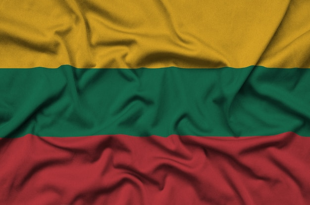 Lithuania flag is depicted on a sports cloth fabric with many folds.