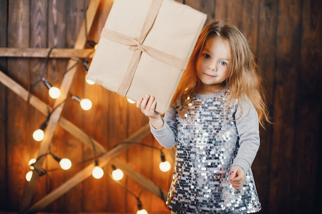 Litle girl opening presents