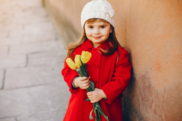 Litlle girl with flowers