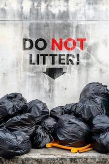Do not litter. black garbage bag
