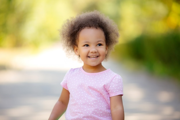 Little african american girl in the summer on a walk