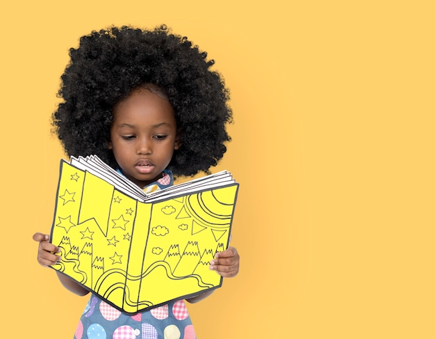 Little african girl reading a book