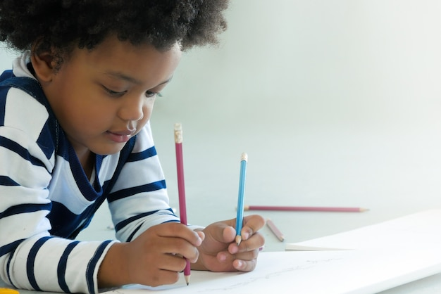 Little africanamerican learn to drawing with pencil adorable