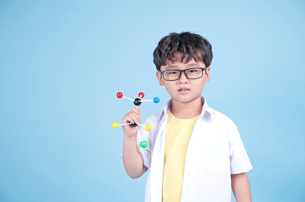 Little asian boy lear science with white blouse