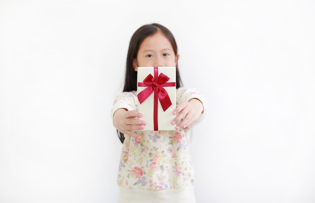 Little asian child girl give you a gift box