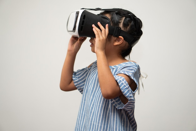 Little asian girl child with virtual reality headset is exciting for new experiencing.