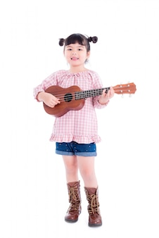 Little asian girl playing ukulele over white background