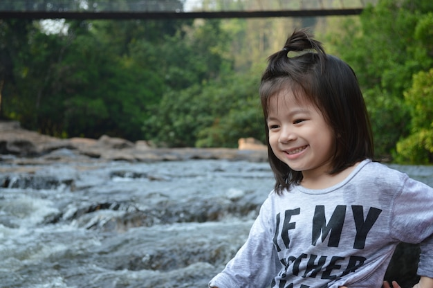 Little asian girl with beautiful natural background.