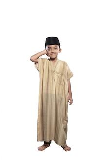 Little asian muslim boy with black cap praying