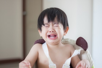 Little baby boy crying and screaming during eating