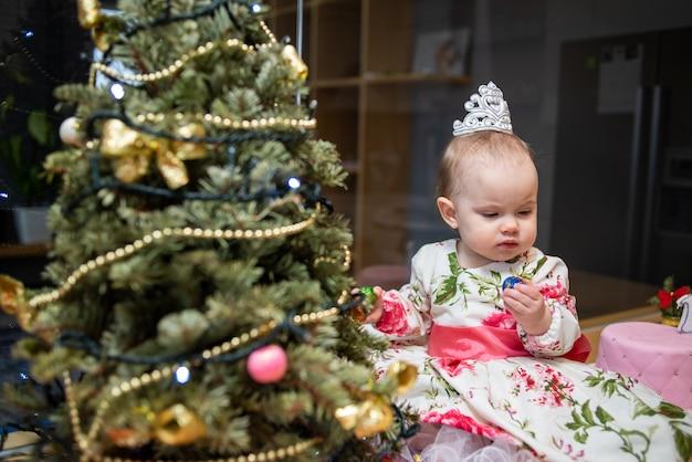 Little baby near new year tree