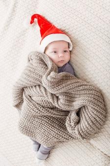Little baby in red santa hat