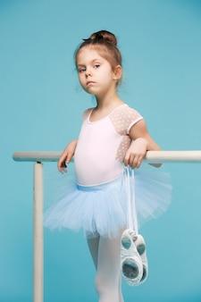 The little balerina dancer on blue background