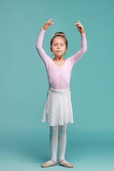 The little balerina dancer on blue space