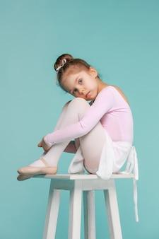 The little balerina dancer on blue wall