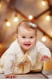 Little beautiful girl in a dress fun creeps