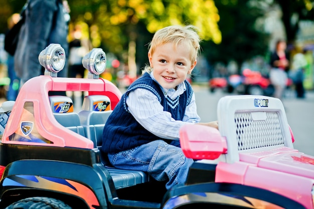 Little and beautiful. handsome little man drives toy outlander