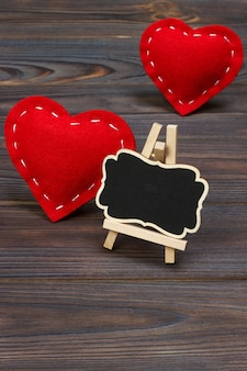 Little blackboard and textile hearts