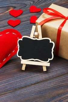 Little blackboard with present and hearts