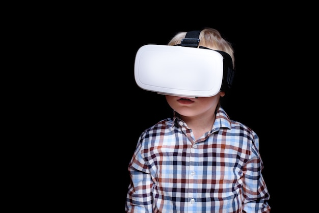 Little blond boy with glasses of virtual reality.