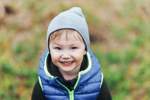 Little blonde boy. unusual appearance and heredity concept. boy is multiracial asian. outdoor walk