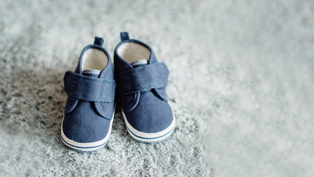 Little blue baby boy shoes, shower invitation concept care, newborn, motherhood.