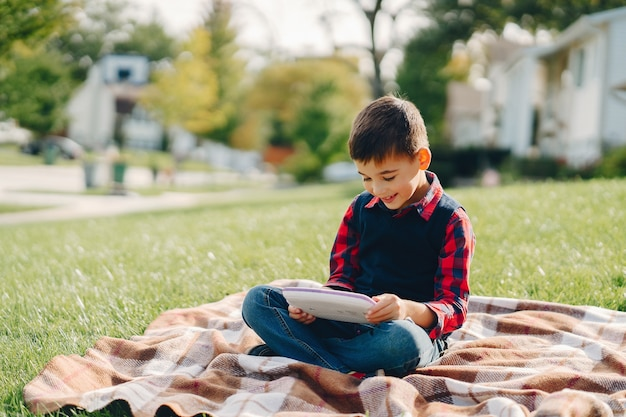 Little boy in a autumn park